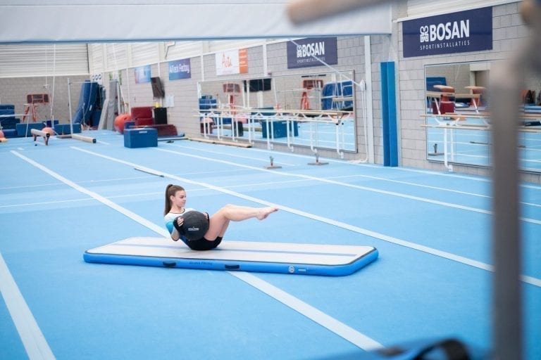 Gymnast training core with the AquaBall on an AirFloor