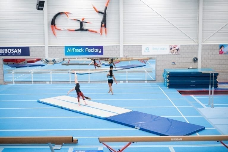 Two gymnasts tumbling AirFloor AirTrack