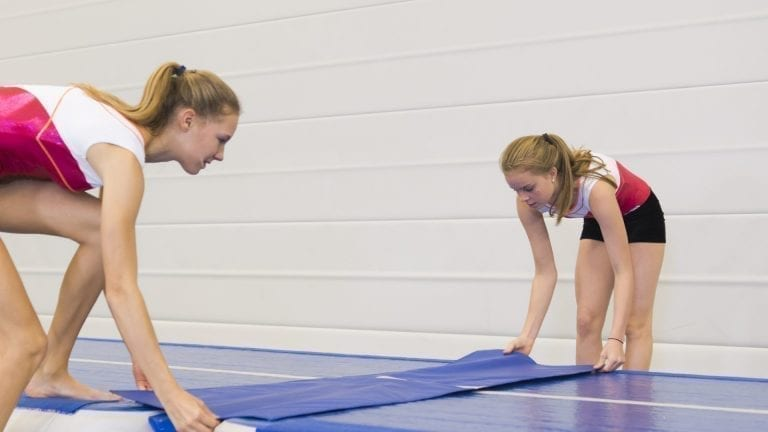 2 gymnasts placing a Trackconnect between 2 AirTracks