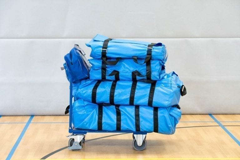 Trolley carrying blue bags