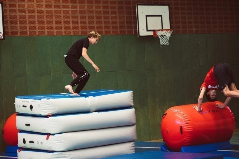 Boy sjumping of an AirBox (an inflatable vaulting table)