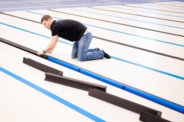 Coach putting in foam connections between AirFloor