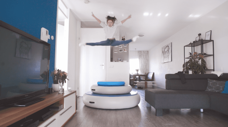 Girl jumping on all AirSpots in livingroom