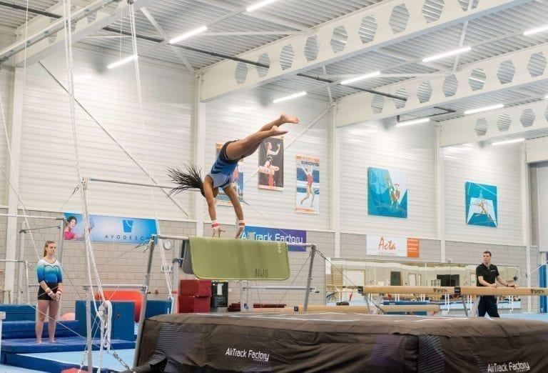 gymnast falling airbag uneven bars
