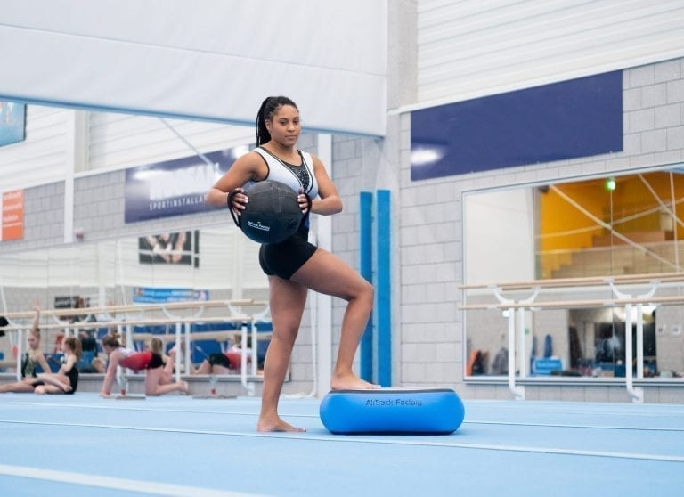 Gymnast with aquabag on airblock