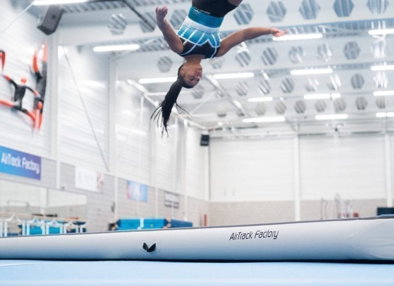 Gymnast jumping high on AirTrack