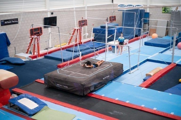 gymnast landing airbag uneven bars