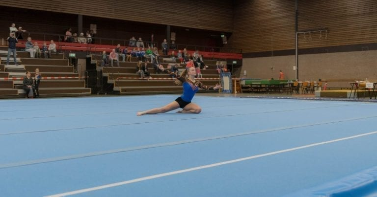 Gymnst performing on the AirTrack Competition Floor