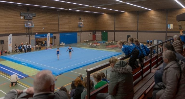 2 gymnasts performing during competition